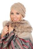 Nettes blondes Mädchen mit Mantelwinterkleidung Stockfotografie