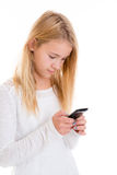 Nettes blondes Mädchen mit Telefon Stockfotografie