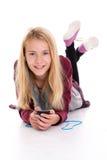 Nettes blondes Mädchenhören misic Lizenzfreie Stockfotos