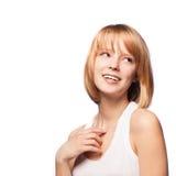 Nettes blondes Mädchenlächeln getrennt auf Weiß. Lizenzfreie Stockfotografie