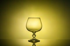 Nettes Glas des Kognakbildes bis zum Licht Lizenzfreies Stockbild
