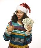 Nettes junges Mädchen in rotem Hut Sankt mit dem Geld lokalisiert Stockbild