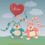 Nettes Kaninchen zwei mit Ballonweg Hearts des Postkarte-Valentinsgrußes auf einem roten Hintergrund Lizenzfreies Stockfoto