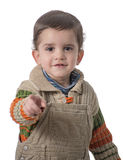 Nettes Kind, das auf Kamera zeigt Stockbilder
