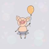 Nettes kleines Schwein, das mit dem Ballon in einer Hand steht Lizenzfreies Stockbild