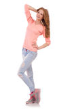 Nettes lächelndes Mädchen in der rosa Bluse und in den Jeans Stockbild