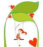 Nettes Mädchen auf einem Blumenschwingen Stockbilder