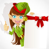 Nettes Mädchen der Weihnachtself mit einer Fahne Stockfotografie