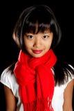 Nettes Mädchen in einem roten Schal Stockbild