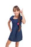 Nettes Mädchen mit dem Finger oben lizenzfreies stockbild