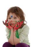 Nettes Mädchen mit den gemalten Händen und Gesicht Stockfotos