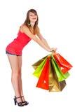 Nettes Mädchen mit Einkaufstaschen Stockbilder