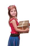 Nettes Mädchen mit Geschenk über Weiß Lizenzfreies Stockbild