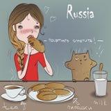 Nettes Mädchen mit Katze essen Stockbilder