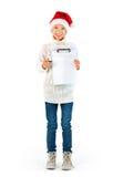 Nettes Mädchen mit Sankt-Hut, der ein leeres Papier zeigt Stockbilder