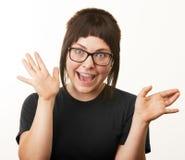 Nettes Mädchen-wellenartig bewegende Hände Stockfoto