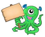 Nettes Monster mit hölzernem Zeichen Lizenzfreie Stockfotografie