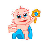 Nettes neugeborenes Baby auf dem Topf und mit einem Geklapper Lizenzfreie Stockbilder