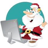 Nettes Sankt-Einkaufen für Weihnachten auf seinem Computer Stockfotos