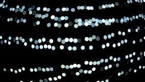 Nettes weißes bokeh führte die Lichter, die nachts blinken stock footage
