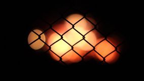 Netting on the background defocused burning fire stock footage