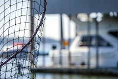Netting with net for fishing in the bay. The fishing netting for catching fish during fishing is made of wicker mesh, worn on a metal frame with a handle for stock photo