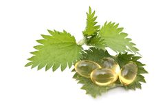 Nettle capsules Stock Photos
