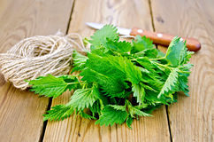 Nettle with a knife and twine on board Stock Images