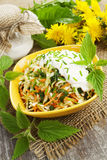 Nettle salad with cabbage. And sour cream stock photography