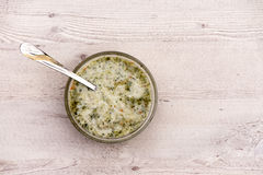 Nettle soup in bowl on wooden background Royalty Free Stock Photo