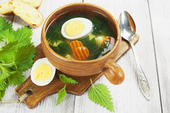 Nettle soup with egg Stock Images