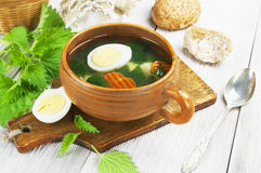 Nettle soup with egg stock image