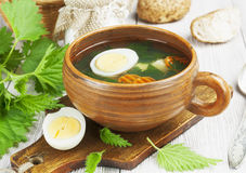Nettle soup with egg Stock Photos