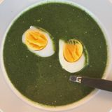 Nettle soup with egg. Stinging nettle & x28;Urtica dioica& x29; soup and two egg halves stock photo