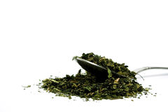 Nettle tea. A spoon full of nettle tea royalty free stock images