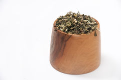 Nettle tea in a wooden bowl Stock Photo
