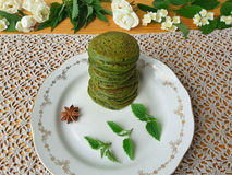 Nettles green pancakes with rose petals, royalty free stock photography