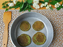 Nettles green pancakes with rose petals, Stock Image