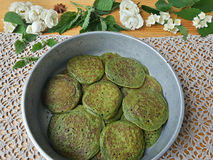 Nettles green pancakes with rose petals, stock photos