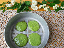 Nettles green pancakes with rose petals, stock images