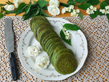 Nettles green pancakes with rose petals, Royalty Free Stock Photos