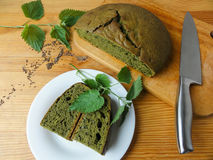 Nettles green round bread, weed dough Stock Photo