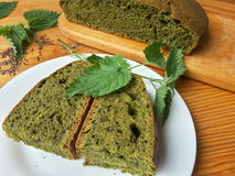 Nettles green round bread, weed dough Royalty Free Stock Images