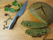 Nettles green round bread, weed dough Stock Photos