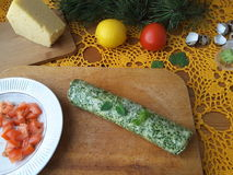 Nettles omelette roll stuffed with tomato and cheese. Cooking vegetarian food with nettles and quail eggs stock photography
