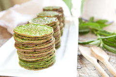 Nettles pancakes. Traditional Scandinavian stinging nettle or spinach pancakes Stock Photography