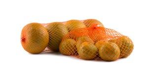 netto apelsiner Fotografering för Bildbyråer