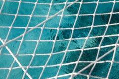 Netto boven de oceaan stock foto