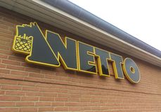 Netto sign / logo. Netto sign on a wall stock photo