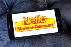 Netto stores logo. Logo of the international chain of convenience stores netto on samsung mobile phone a5 Stock Photography